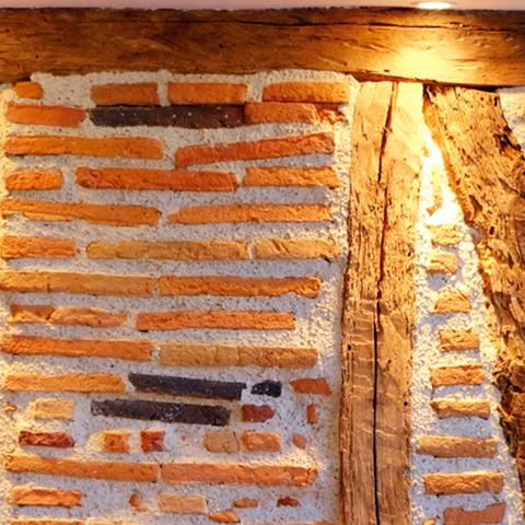 A half-timbered wall in a room in the Préau Saint-Jacques, guest house in Castres